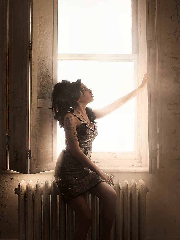 portrait photo of Amy Winehouse in monochrome in front of a window
